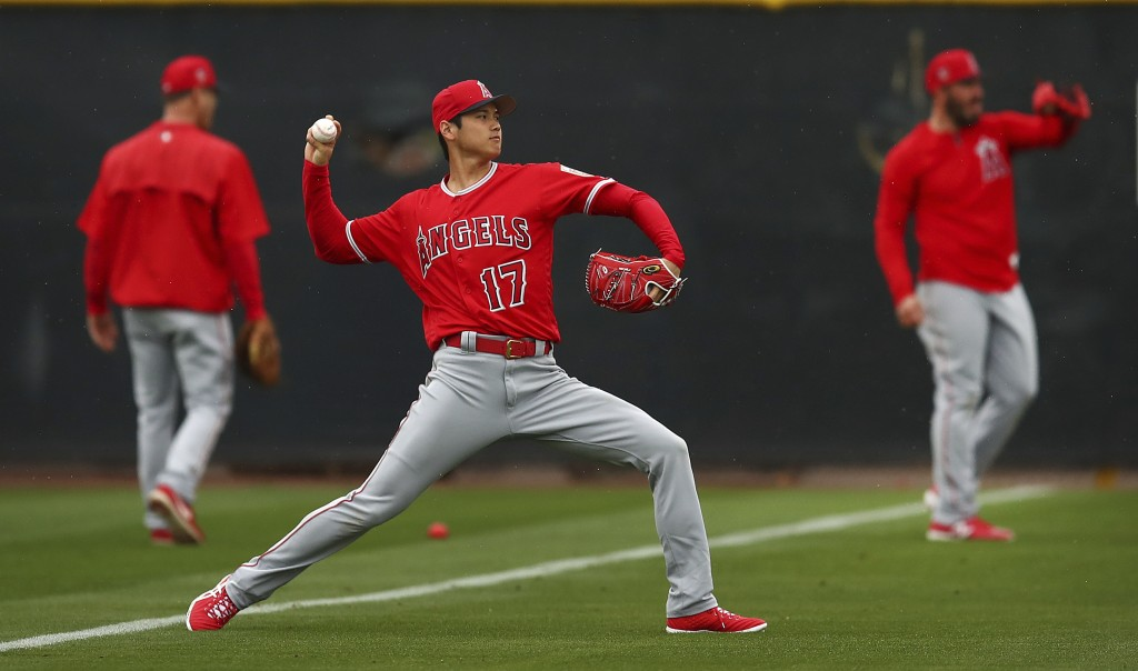 Los Angeles Angels' Shohei Ohtani (17) throws during a spring training baseball practice on Wednesday, Feb. 14, 2018, in Tempe, Ariz. (AP Photo/Ben Ma