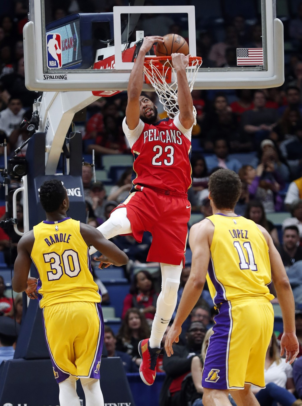 New Orleans Pelicans forward Anthony Davis (23) dunks as Los Angeles Lakers forward Julius Randle (30) and center Brook Lopez (11) watch during the fi