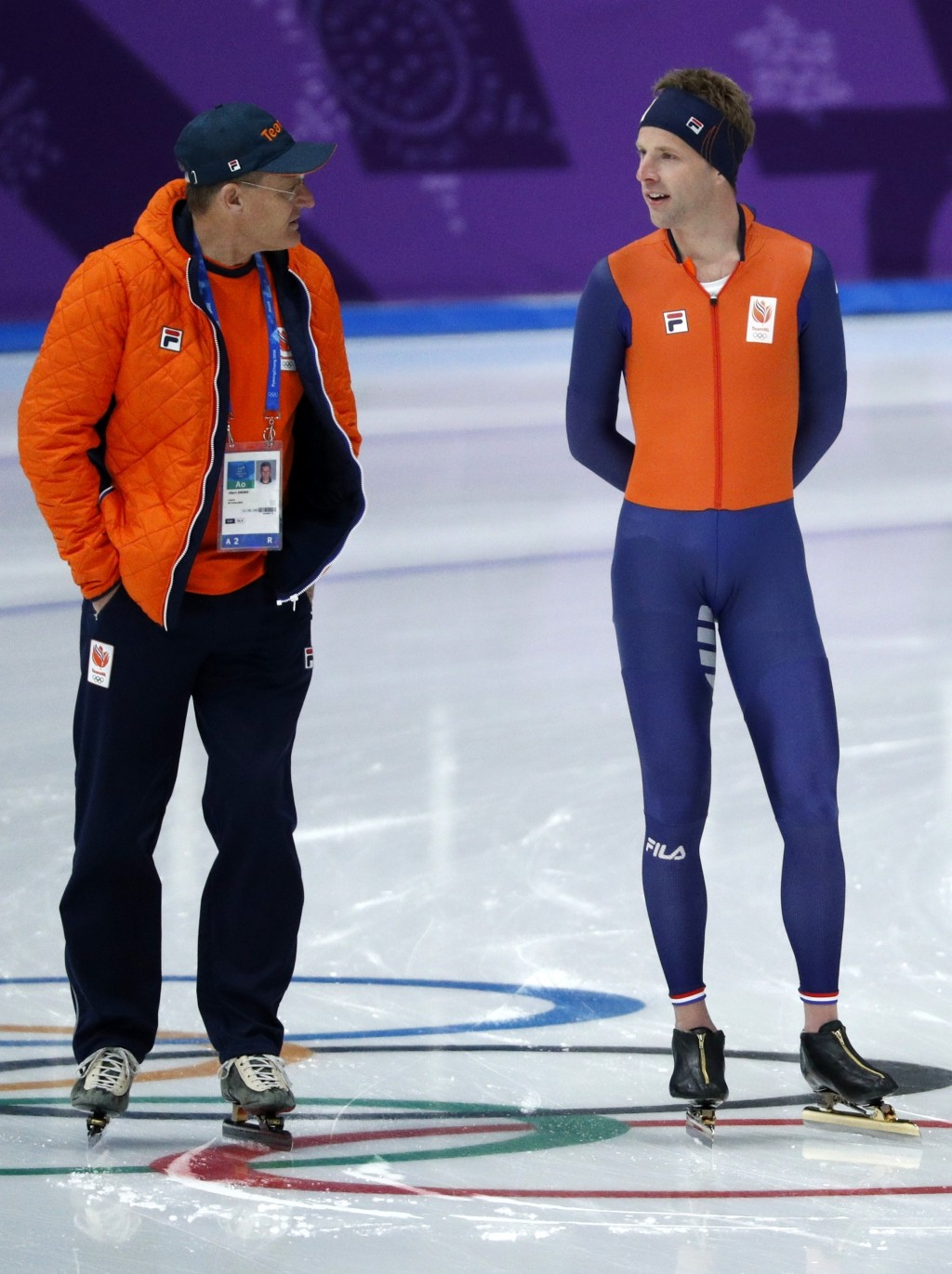 FILE - In this Feb. 10, 2018 file photo Bob de Vries, right, of the Netherlands talks to coach Jillert Anema, left, of the Netherlands during the offi