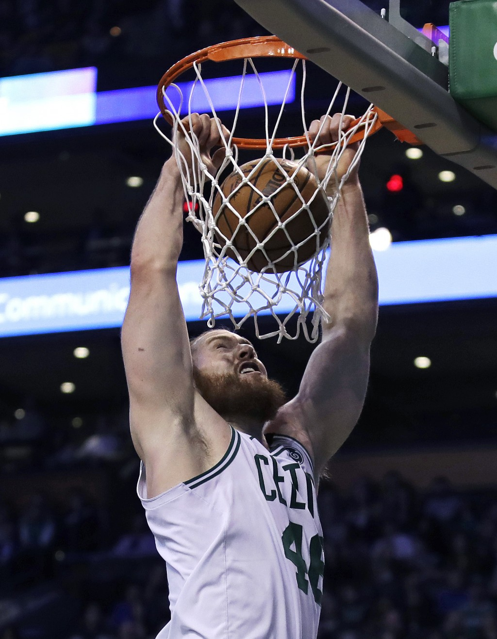Boston Celtics center Aron Baynes dunks during the first quarter of the team's NBA basketball game against the Los Angeles Clippers in Boston, Wednesd