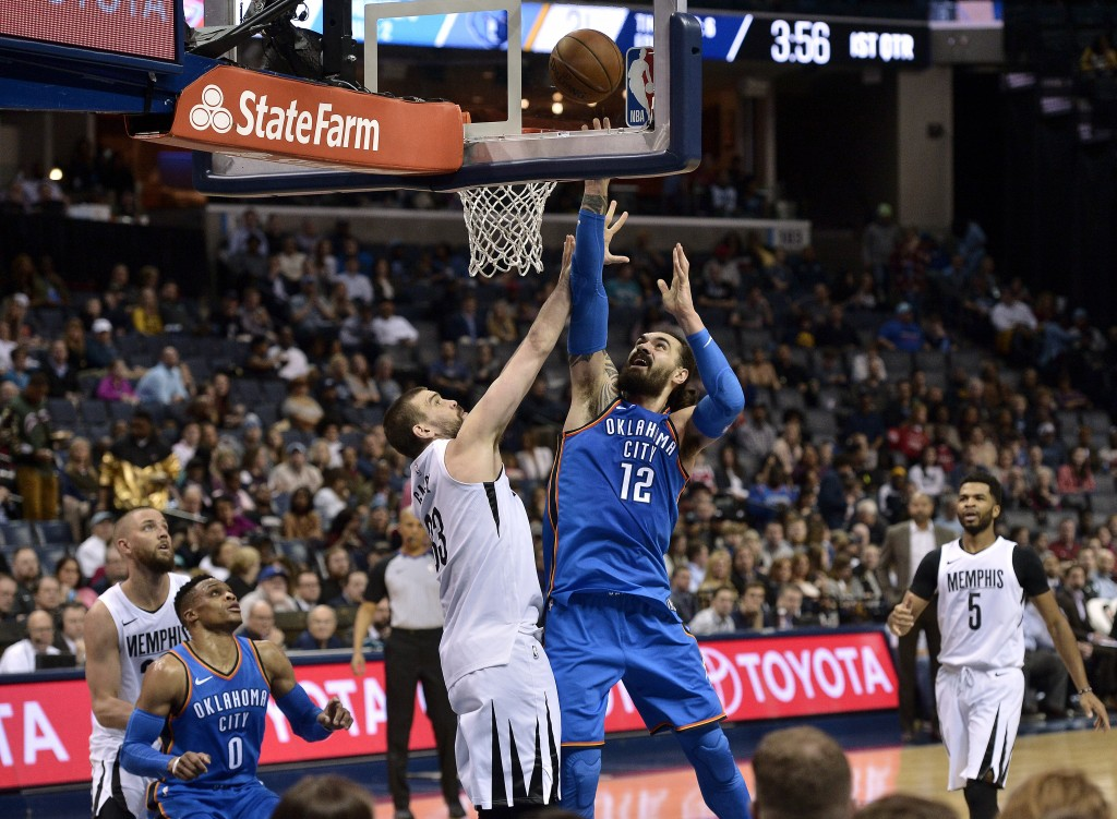 Oklahoma City Thunder center Steven Adams (12) shoots against Memphis Grizzlies center Marc Gasol (33) in the first half of an NBA basketball game Wed