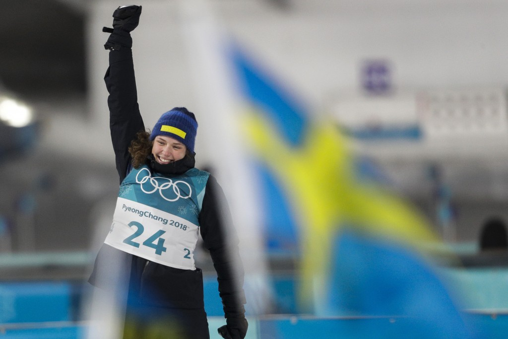 Gold medal winner Hanna Oeberg, of Sweden, celebrates her victory during the venue ceremony at the women's 15-kilometer individual biathlon at the 201