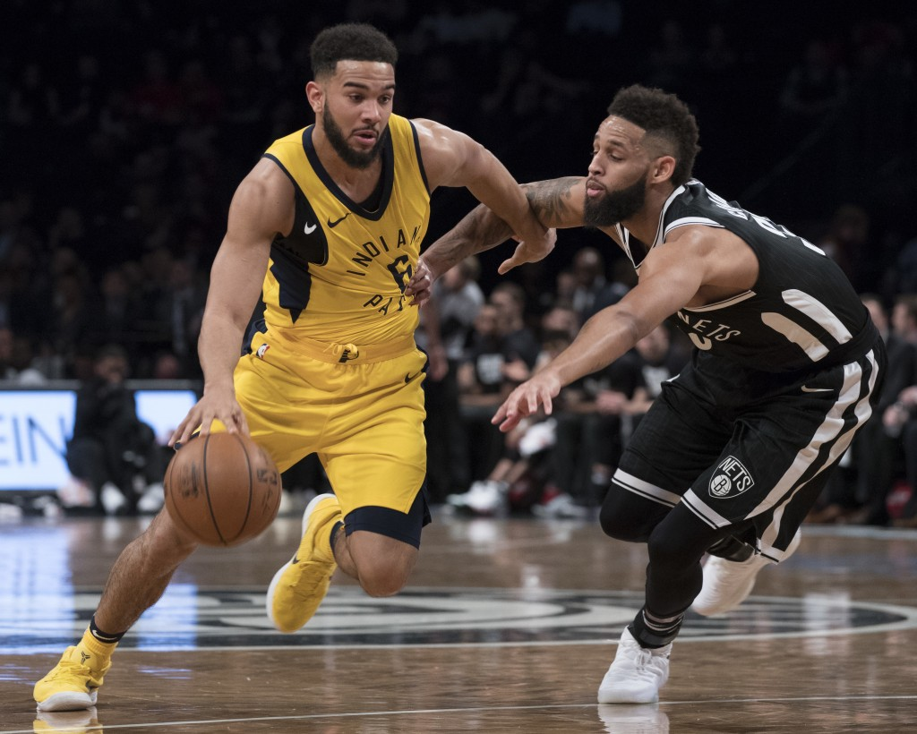 Indiana Pacers guard Cory Joseph (6) drives to the basket against Brooklyn Nets guard Allen Crabbe during the first half of an NBA basketball game Wed