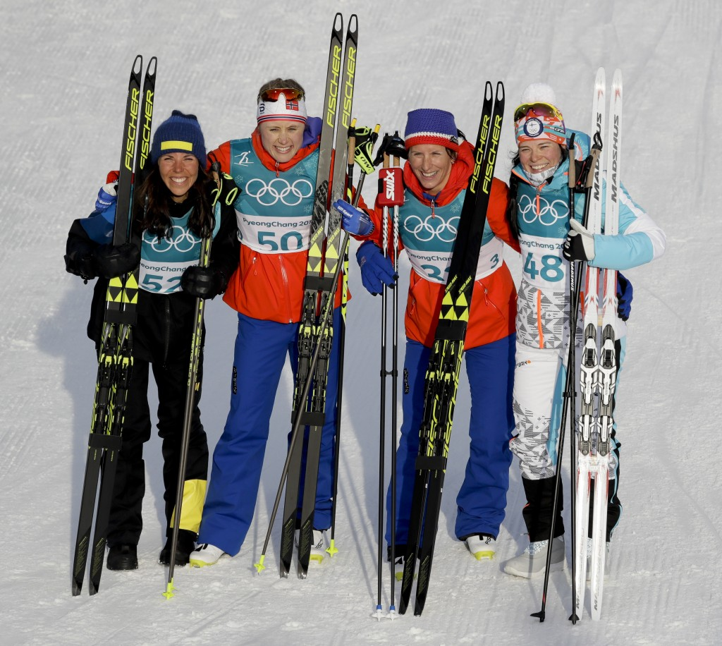 Gold medal winner Ragnhild  Haga, of Norway, is flanked by silver medal winner Charlotte  Kalla, of Sweden, left, and bronze medal winners Marit  Bjoe