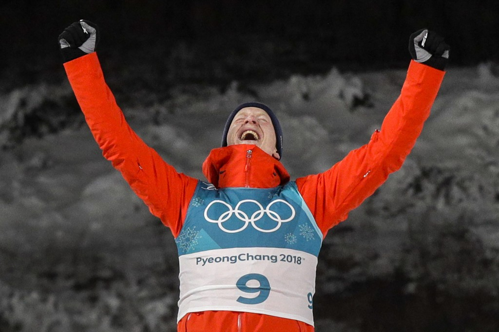 Johannes Thingnes Boe, of Norway, celebrates his gold medal during the venue ceremony after the men's 20-kilometer individual biathlon at the 2018 Win