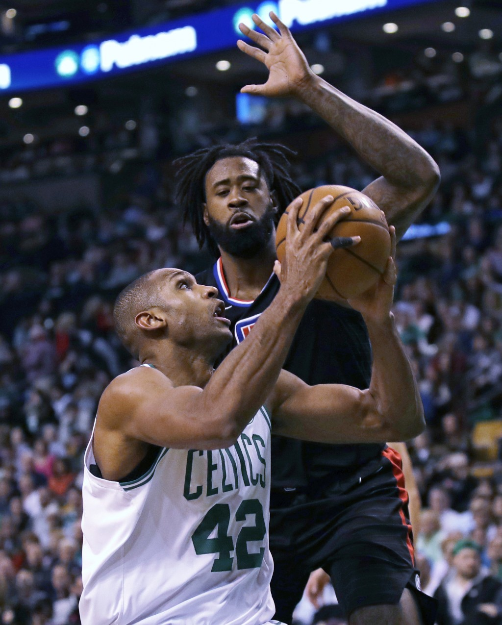 Los Angeles Clippers center DeAndre Jordan, rear, prepares to block a shot by Boston Celtics forward Al Horford (42) during the second quarter of an N