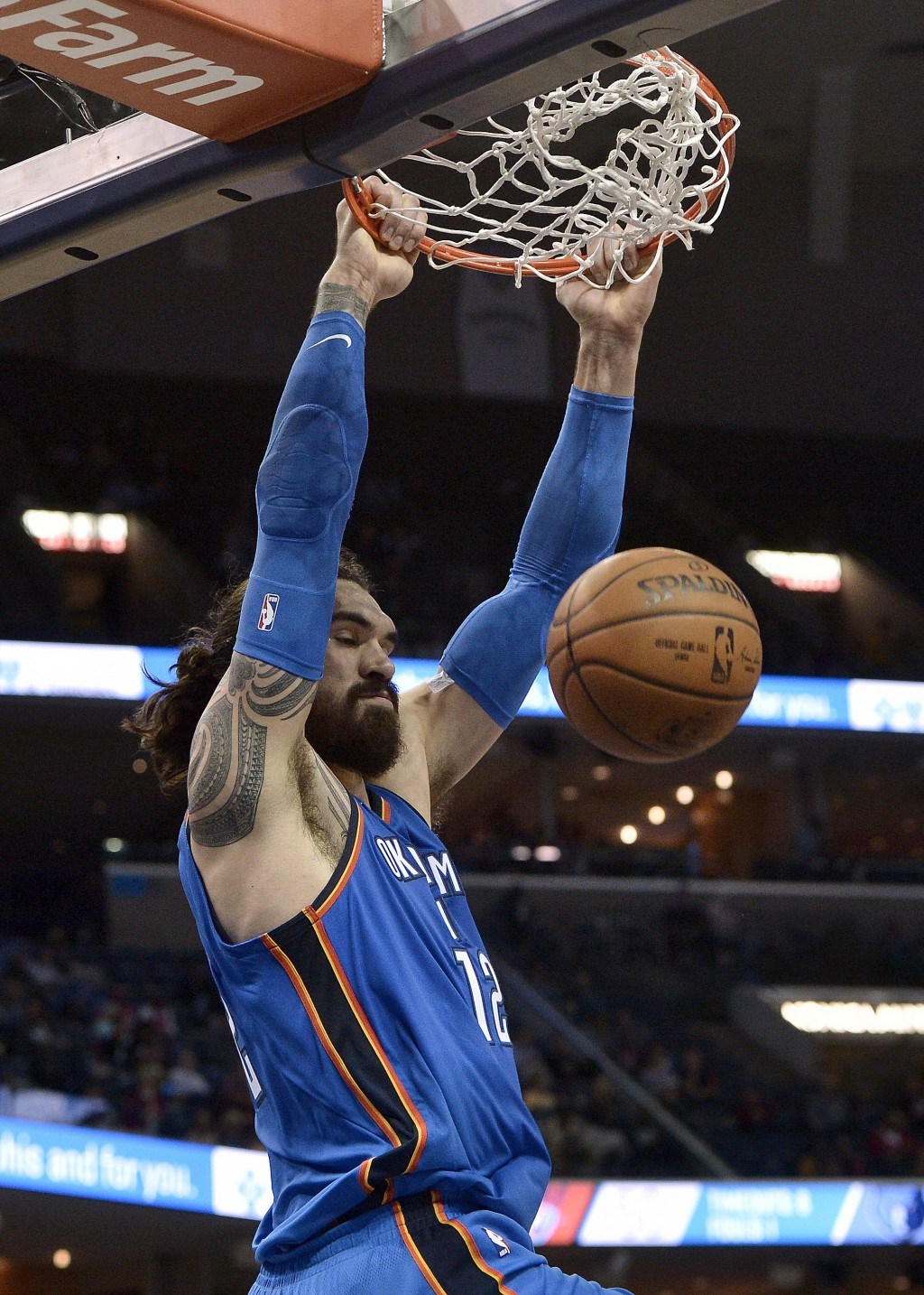 Oklahoma City Thunder center Steven Adams (12) dunks the ball in the first half of an NBA basketball game against the Memphis Grizzlies Wednesday, Feb