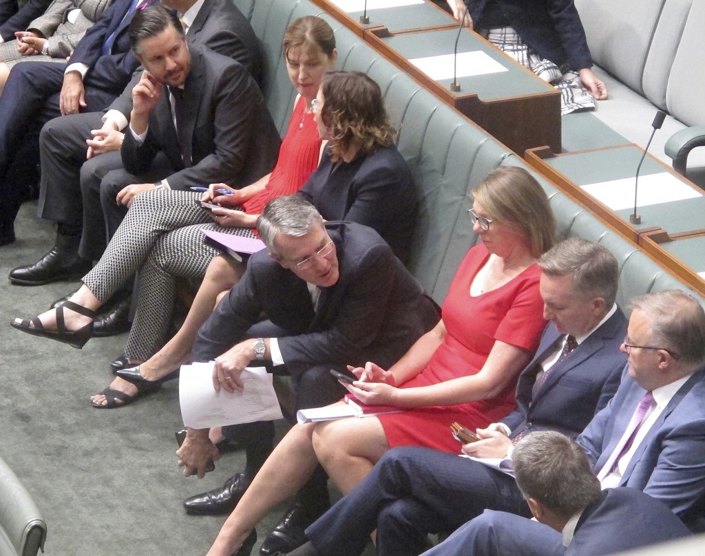 Australia's opposition lawmaker Mark Dreyfus, center, sits with colleagues during a session in the Australian Parliament in Canberra, Thursday, Feb. 1