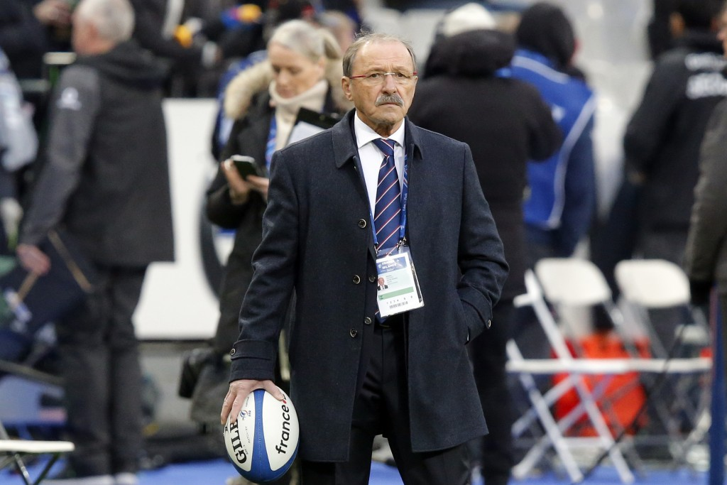 FILE - In this file photo dated Saturday, Feb. 3, 2018, France's rugby coach Jacques Brunel watches his players prior to the Six Nations rugby union m