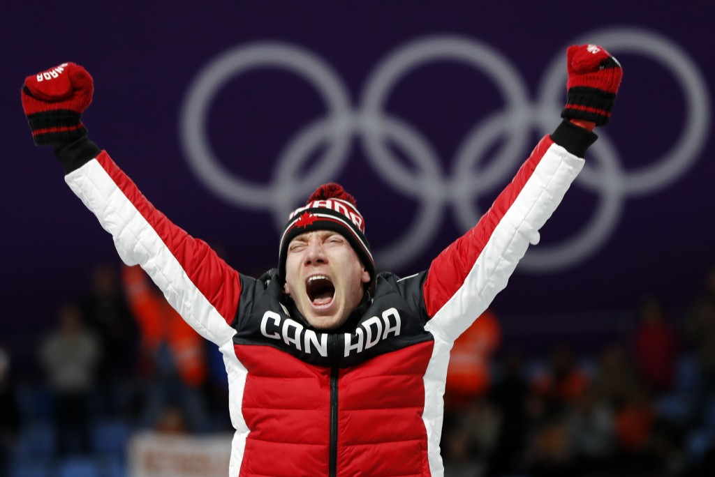 Gold medallist Ted-Jan Bloemen of Canada celebrates on the podium after the men's 10,000 meters speedskating race at the Gangneung Oval at the 2018 Wi