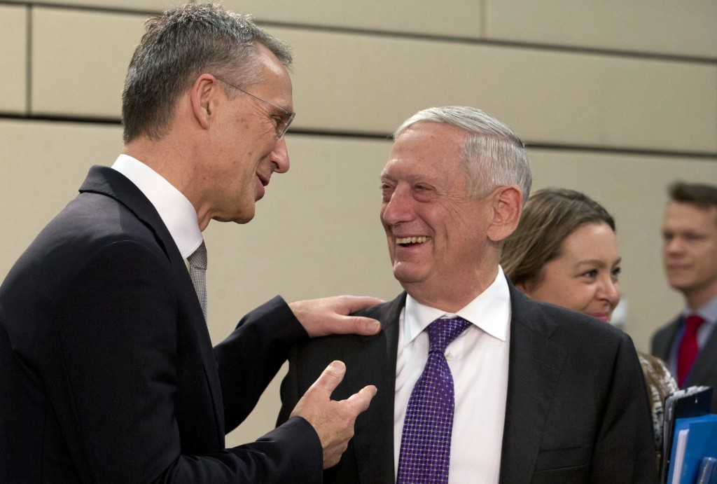 NATO Secretary General Jens Stoltenberg, left, speaks with U.S. Secretary for Defense Jim Mattis during a meeting of the North Atlantic Council at NAT