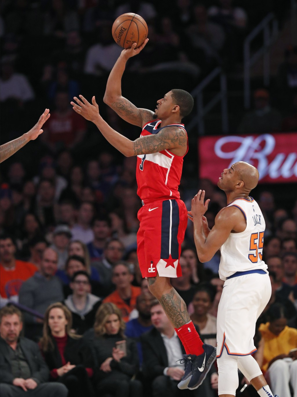 Washington Wizards guard Bradley Beal (3) shoots as New York Knicks guard Jarrett Jack (55) in the second half of an NBA basketball game in New York,