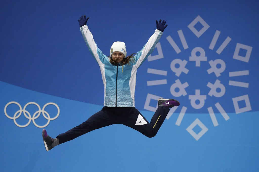 Women's moguls bronze medalist Yulia Galysheva, of Kazakhstan, celebrates during the medals ceremony at the 2018 Winter Olympics in Pyeongchang, South
