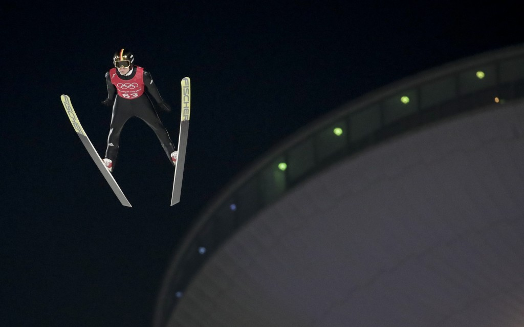 Andreas Wellinger, of Germany, soars through the air during training for the men's large hill individual ski jumping competition at the 2018 Winter Ol