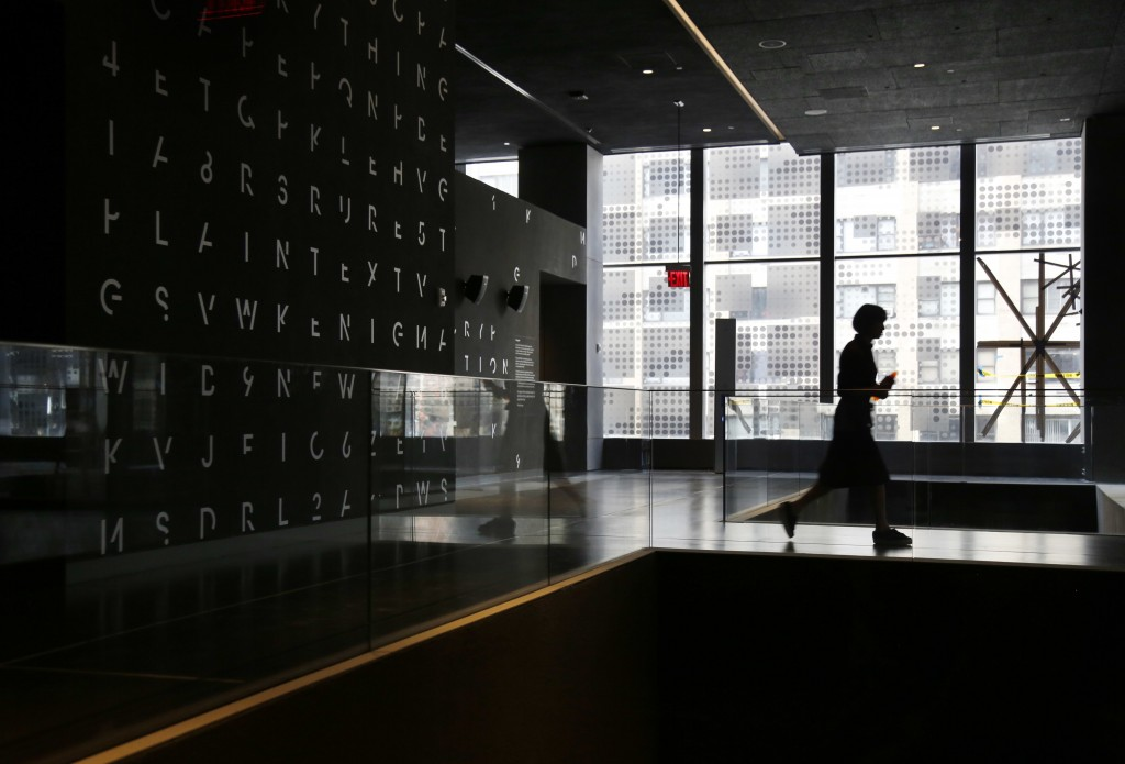 In this Monday, Feb. 12, 2018 photo, artwork suggesting cryptography is displayed at SPYSCAPE in New York. Visitors to a new attraction opening in New