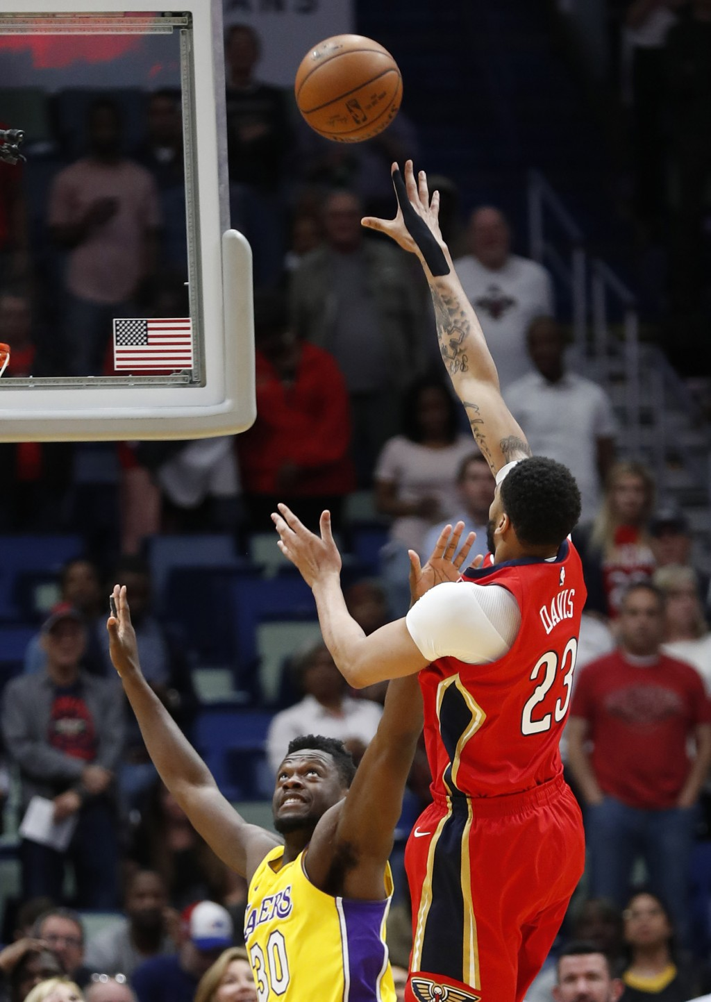 New Orleans Pelicans forward Anthony Davis (23) shoots over Los Angeles Lakers forward Julius Randle (30) during the first half of an NBA basketball g