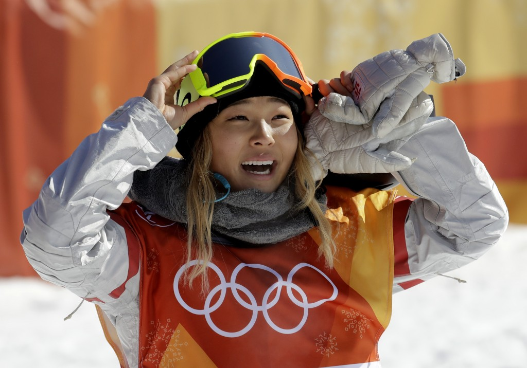 FILE - In this Tuesday, Feb. 13, 2018 file photo, ChloeKim, of the United States, smiles during the women's halfpipe finals at Phoenix Snow Park at t