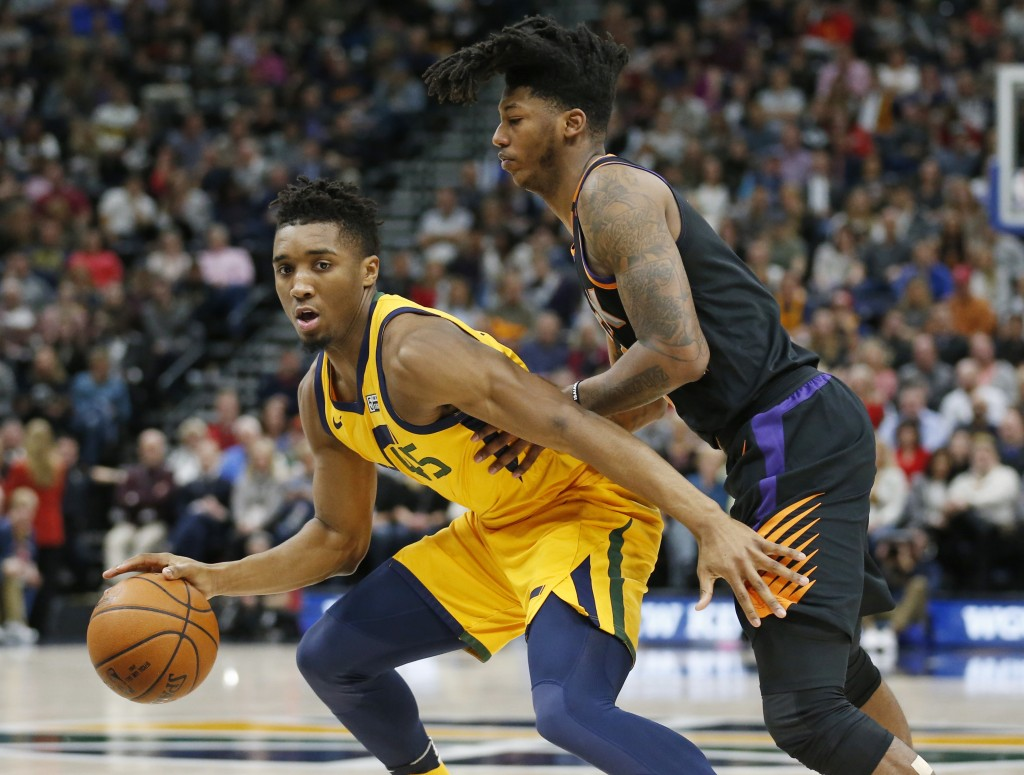 Phoenix Suns guard Elfrid Payton, right, guards Utah Jazz guard Donovan Mitchell, left, in the first half during an NBA basketball game Wednesday, Feb