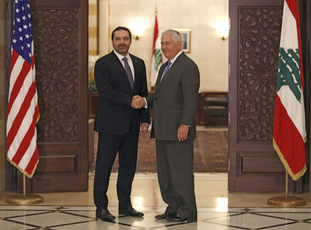 Lebanese Prime Minister Saad Hariri, left, shakes hands with U.S. Secretary of State Rex Tillerson, at the Government House, in Beirut, Lebanon, Thurs