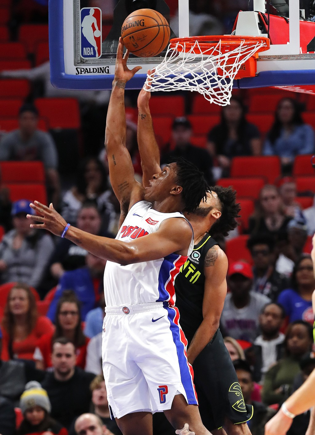 Detroit Pistons forward Stanley Johnson (7) drives on Atlanta Hawks guard Tyler Dorsey (2) in the first half of an NBA basketball game in Detroit, Wed