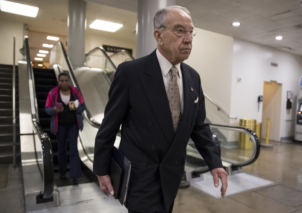 Senate Judiciary Committee Chairman Chuck Grassley, R-Iowa, walks through a basement passageway at the Capitol amid debates in the Senate on immigrati