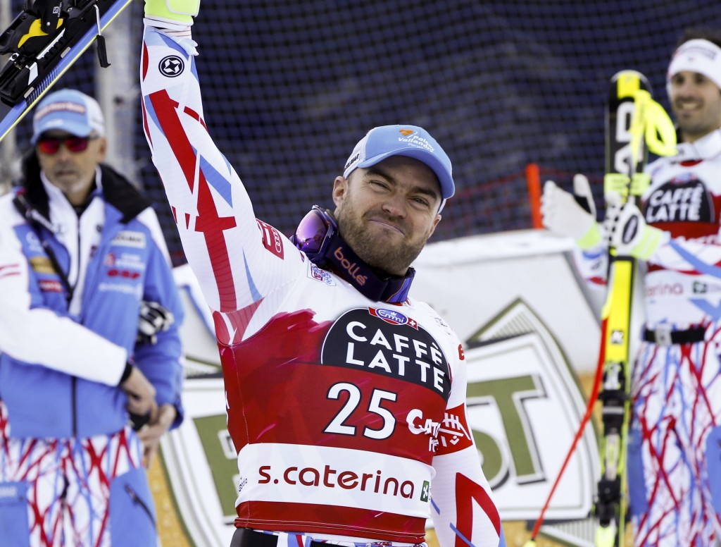 FILE - In this Dec. 29, 2015 file photo, France's David Poisson celebrates his third place after completing a men's World Cup downhill in Santa Cateri