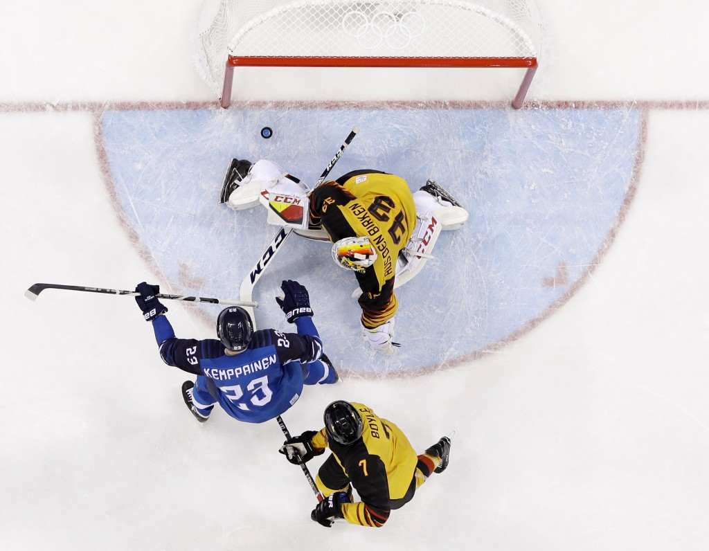Joonas Kemppainen (23), of Finland, shoots a goal against Den Birken Danny Aus (33), of Germany, during the third period of the preliminary round of t