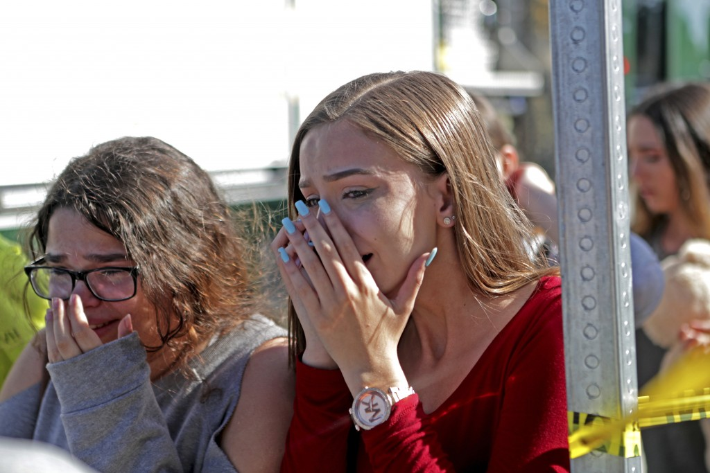 Students released from a lockdown are overcome with emotion following following a shooting at Marjory Stoneman Douglas High School in Parkland, Fla.,