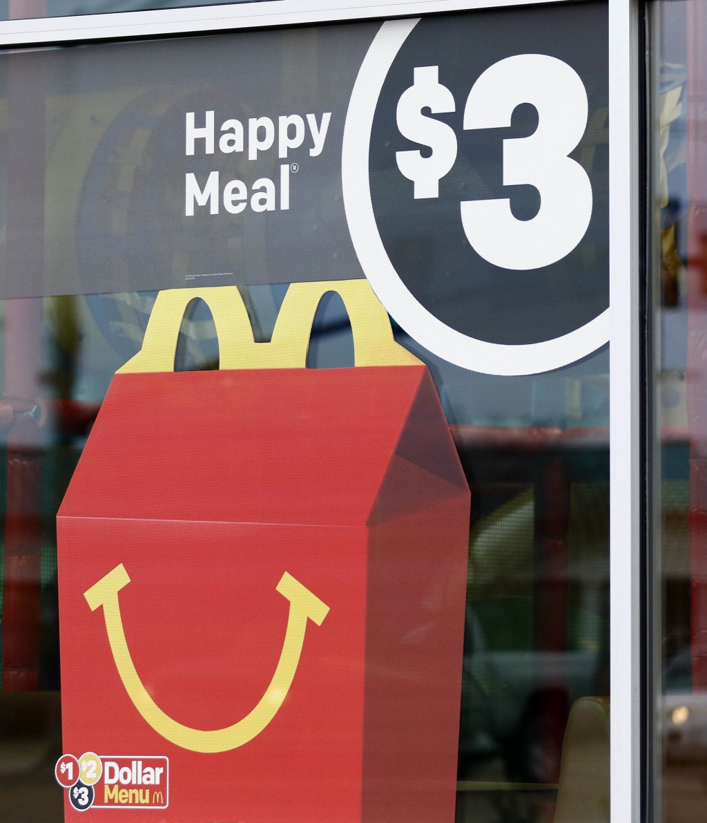 A $3 Happy Meal is advertised at a McDonald's restaurant in Brandon, Miss., Wednesday, Feb. 14, 2018. McDonald's will soon banish cheeseburgers and ch