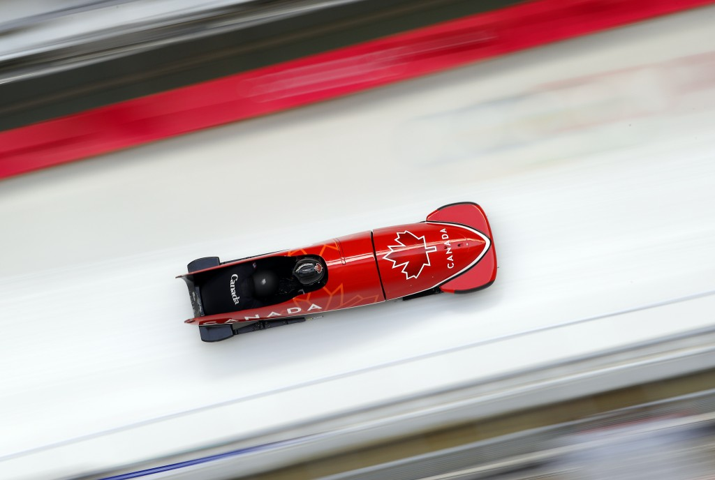 Driver Christopher Spring and Neville Wright of Canada take a practice run during training for the two-man bobsled at the 2018 Winter Olympics in Pyeo