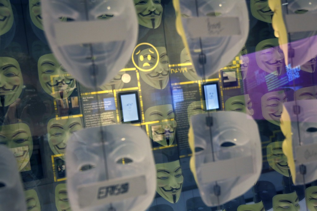 In this Monday, Feb. 12, 2018 photo, Guy Fawkes masks, often associated with the hacker group Anonymous, are displayed in a section about hacking at S