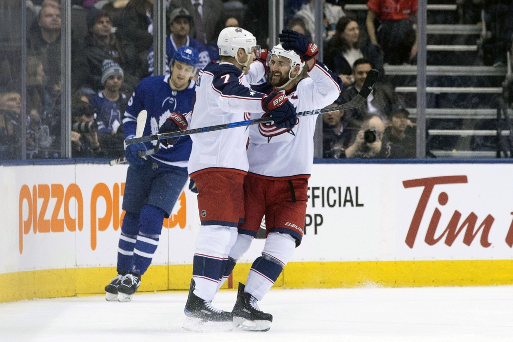 Columbus Blue Jackets Jack Johnson, left, celebrates his goal with teammate Nick Foligno against Toronto Maple Leafs during the second period of an NH