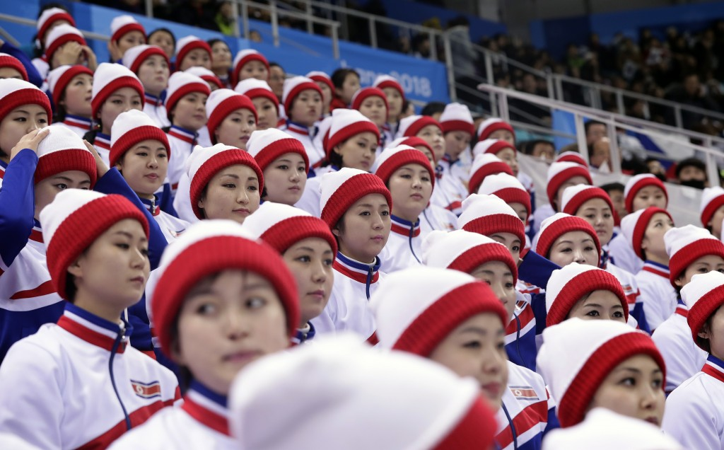 Supporters from North Korea wait before the preliminary round of the men's hockey game between the Czech Republic and South Korea at the 2018 Winter O
