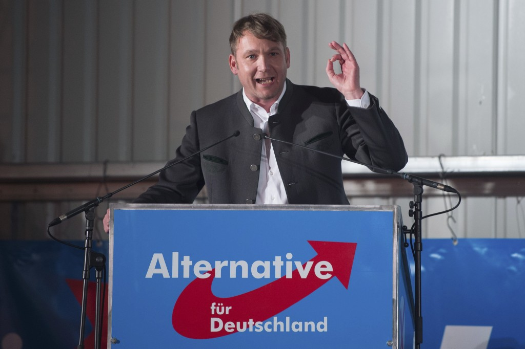 In this Feb. 14, 2018 photo Andre Poggenburg, head of the nationalist AfD in German state of Saxony-Anhalt, speaks during a party rally in Nentmannsdo