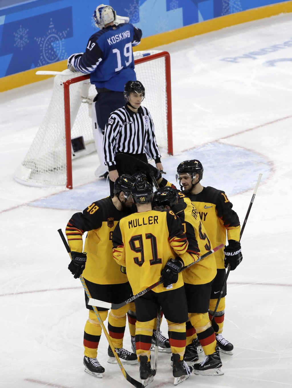 Frank Hordler (48), of Germany, celebrates a goal with his teammates during the third period of the preliminary round of the men's hockey game against