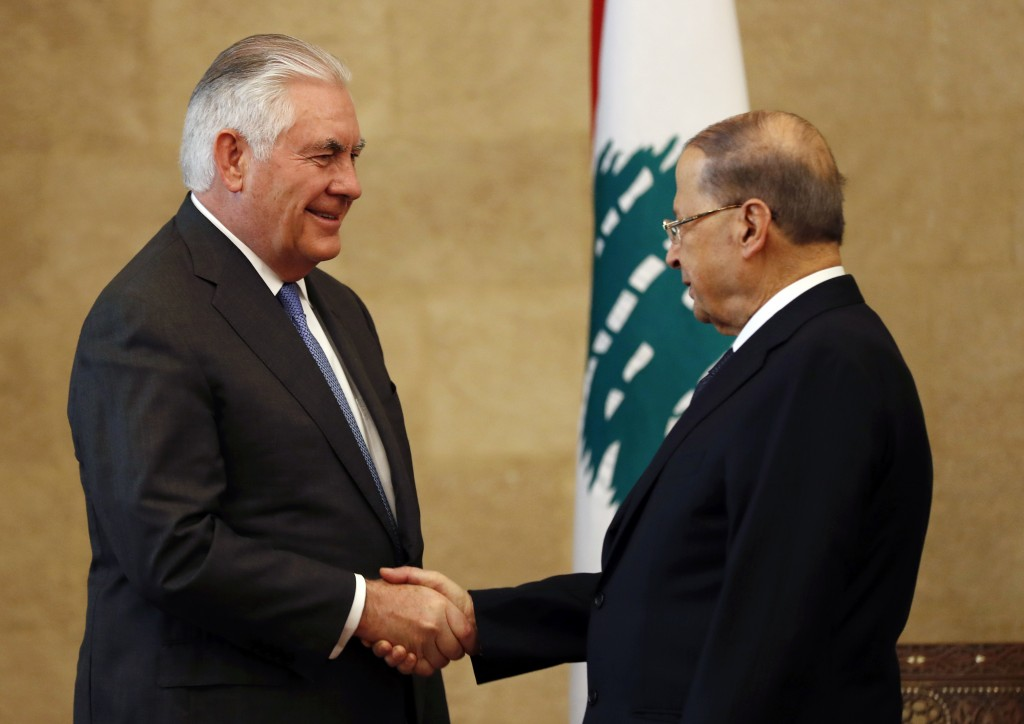 Lebanese President Michel Aoun, right, shakes hands with U.S. Secretary of State Rex Tillerson at the presidential palace in Baabda, east of Beirut, L