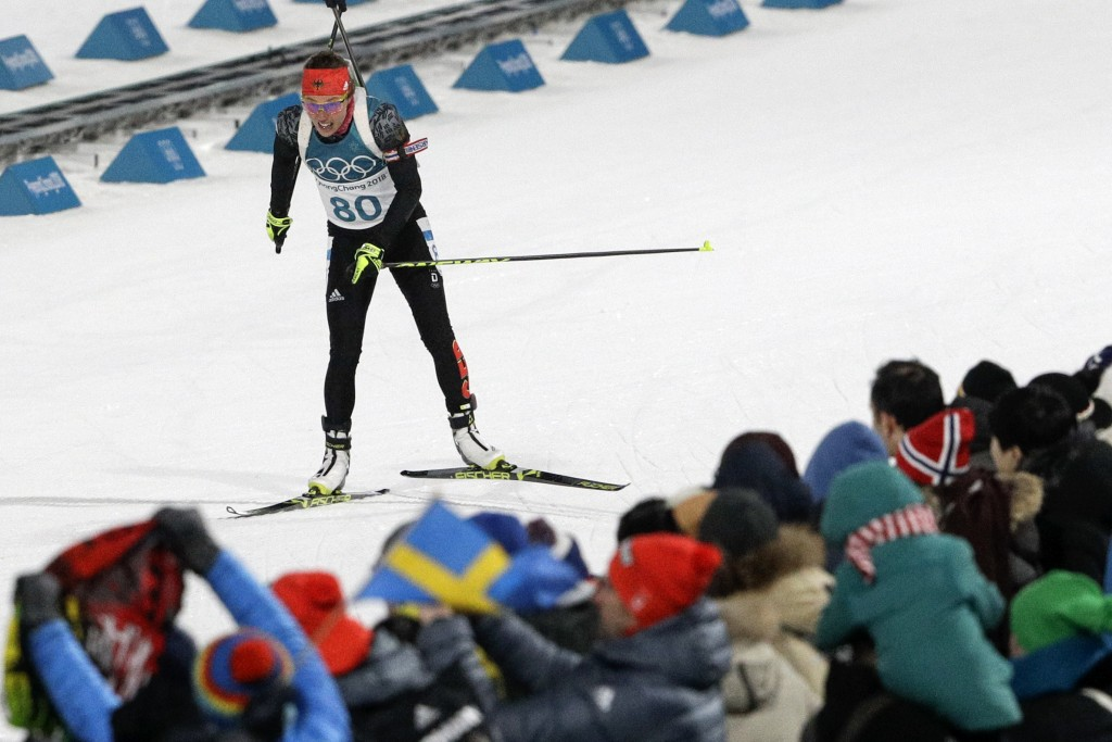 Laura Dahlmeier, of Germany, skis across the finish line for a bronze medal during the women's 15-kilometer individual biathlon at the 2018 Winter Oly