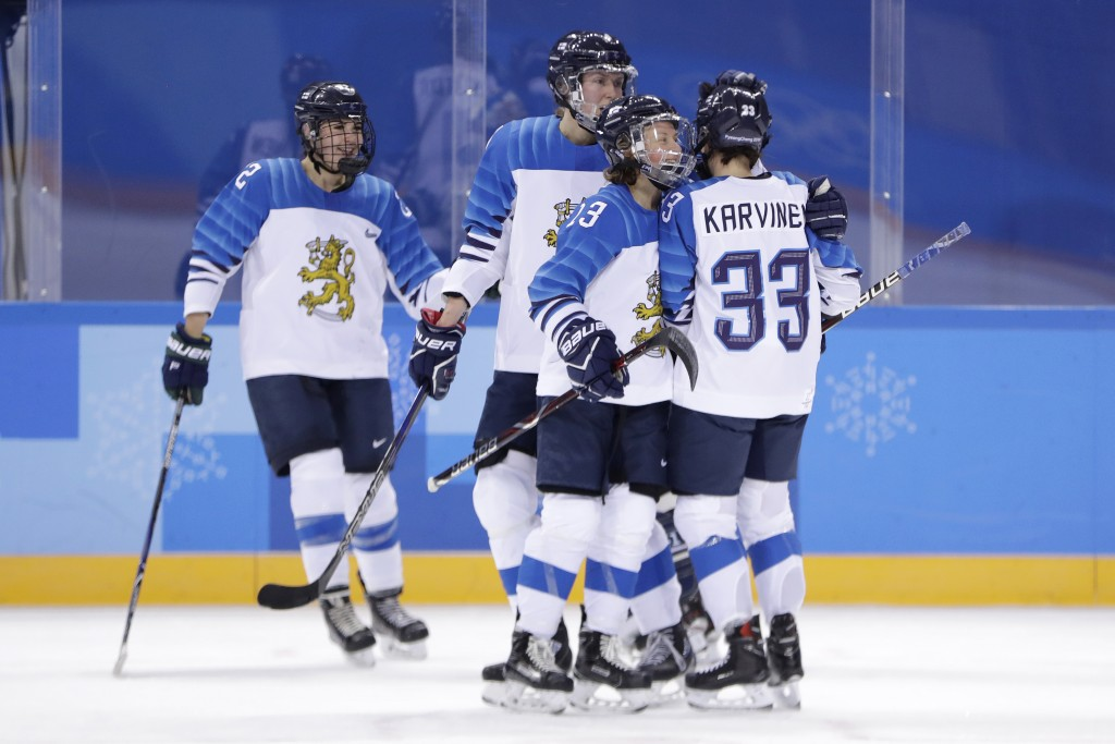 Michelle Karvinen (33), of Finland, is congratulated by teammates, from left, Emma Nuutinen, Rosa Lindstedt and Riikka Valila after scoring a goal on