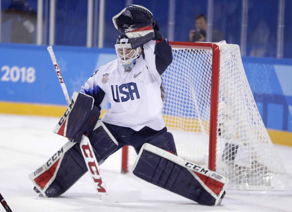 United States goalie Maddie Rooney traps the puck on a shot by Canada during the first period of a preliminary round during a women's hockey game at t
