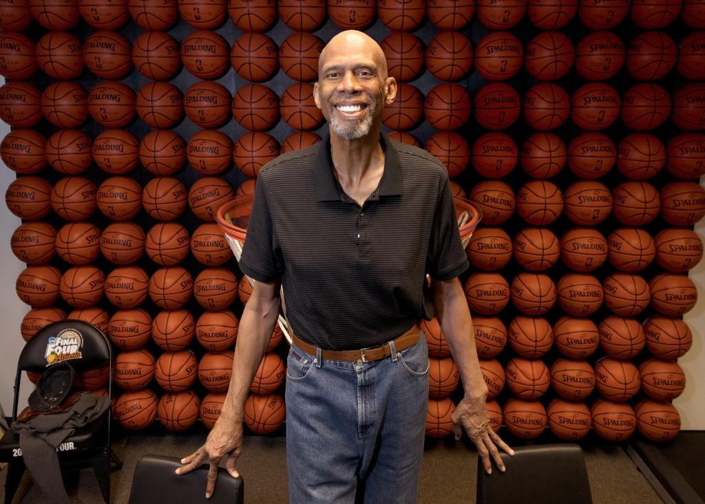 In this Monday, Feb. 12, 2018 photo, Kareem Abdul-Jabbar poses in his office, in Newport Beach, Calif. Abdul-Jabbar has been a best-selling author, ci