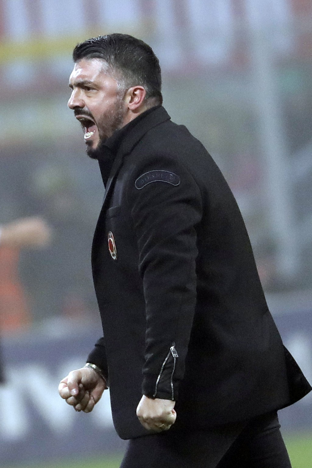 FILE - In this Jan. 28, 2018 file photo, AC Milan coach Gennaro Gattuso celebrates a 2-1 win at the end of a Serie A soccer match between AC Milan and