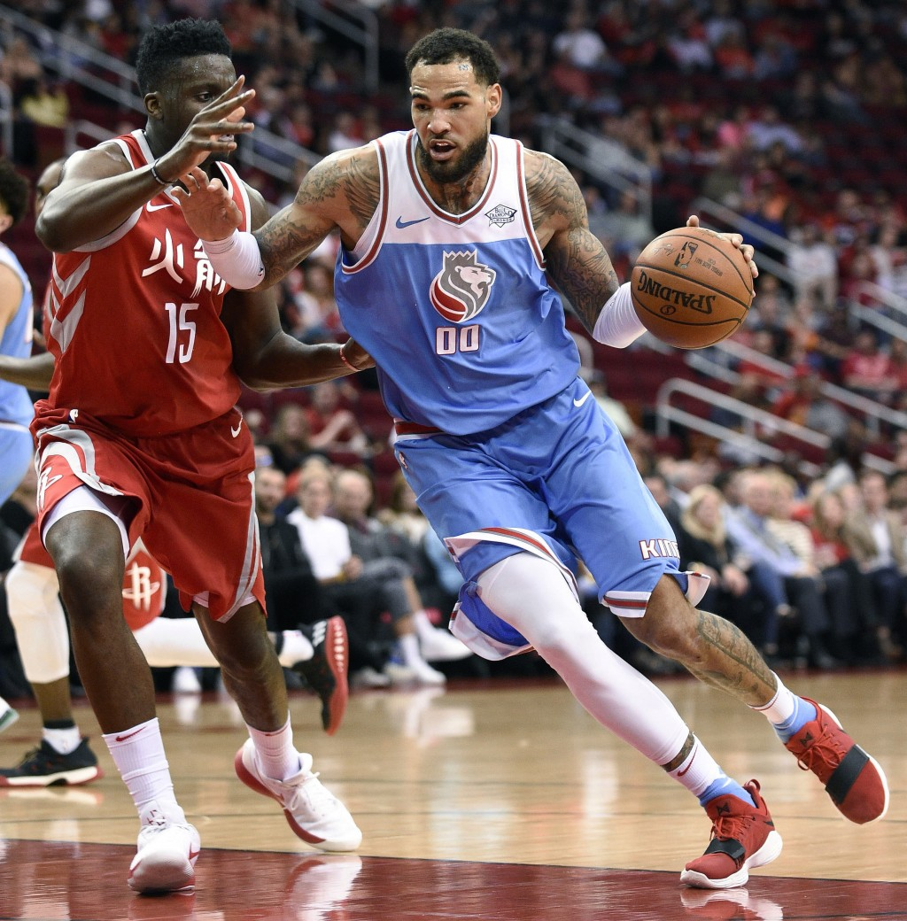 Sacramento Kings center Willie Cauley-Stein (00) drives to the basket as Houston Rockets center Clint Capela defends during the first half of an NBA b