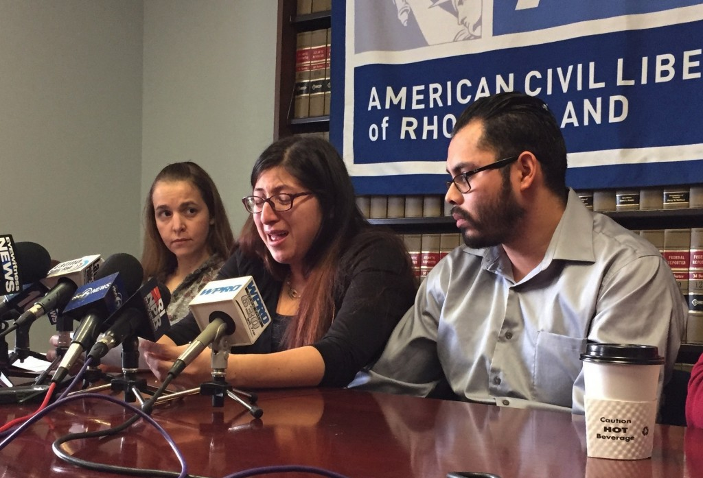 Lilian Calderon, center, cries as she describes her experiences while in custody, as her husband, Luis Gordillo, right,  looks on, during a news confe