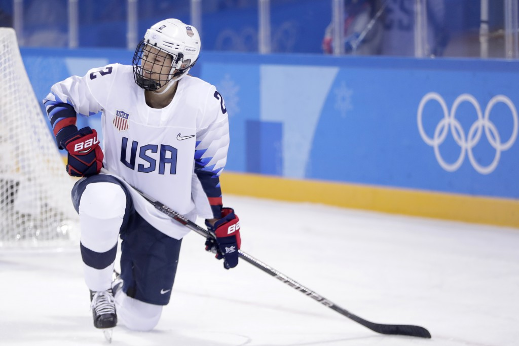 Lee Stecklein (2), of the United States, is slow to get up after being charged with a penalty during the first period of a preliminary round during a