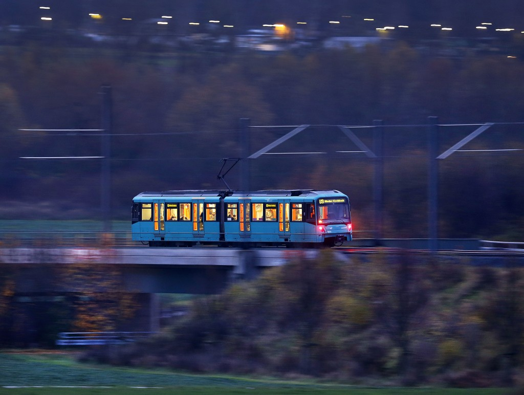 FILE - In this Nov. 24, 2017 file photo a short subway train carries commuters and pupils in the outskirts of Frankfurt, Germany. German ministers hav