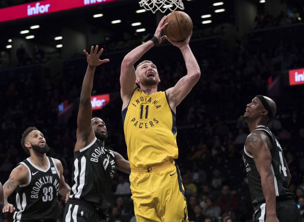 Indiana Pacers center Domantas Sabonis (11) goes to the basket past Brooklyn Nets guard Allen Crabbe (33, forward DeMarre Carroll (9) and forward Dant