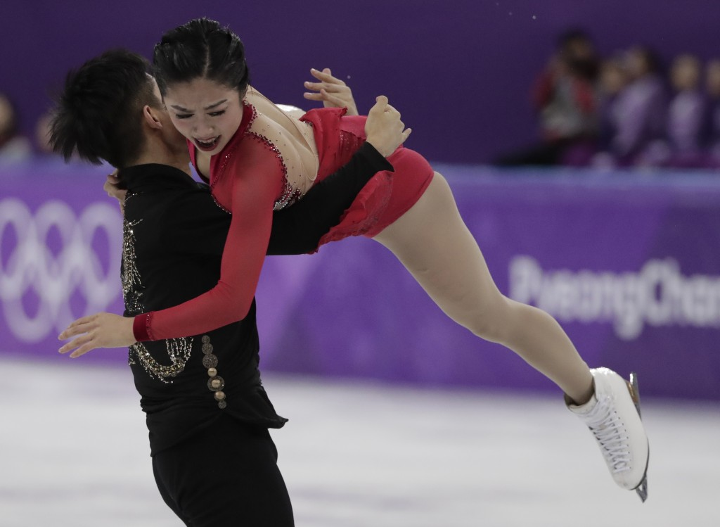Sui Wenjing and Han Cong of China perform in the pairs free skate figure skating final in the Gangneung Ice Arena at the 2018 Winter Olympics in Gangn