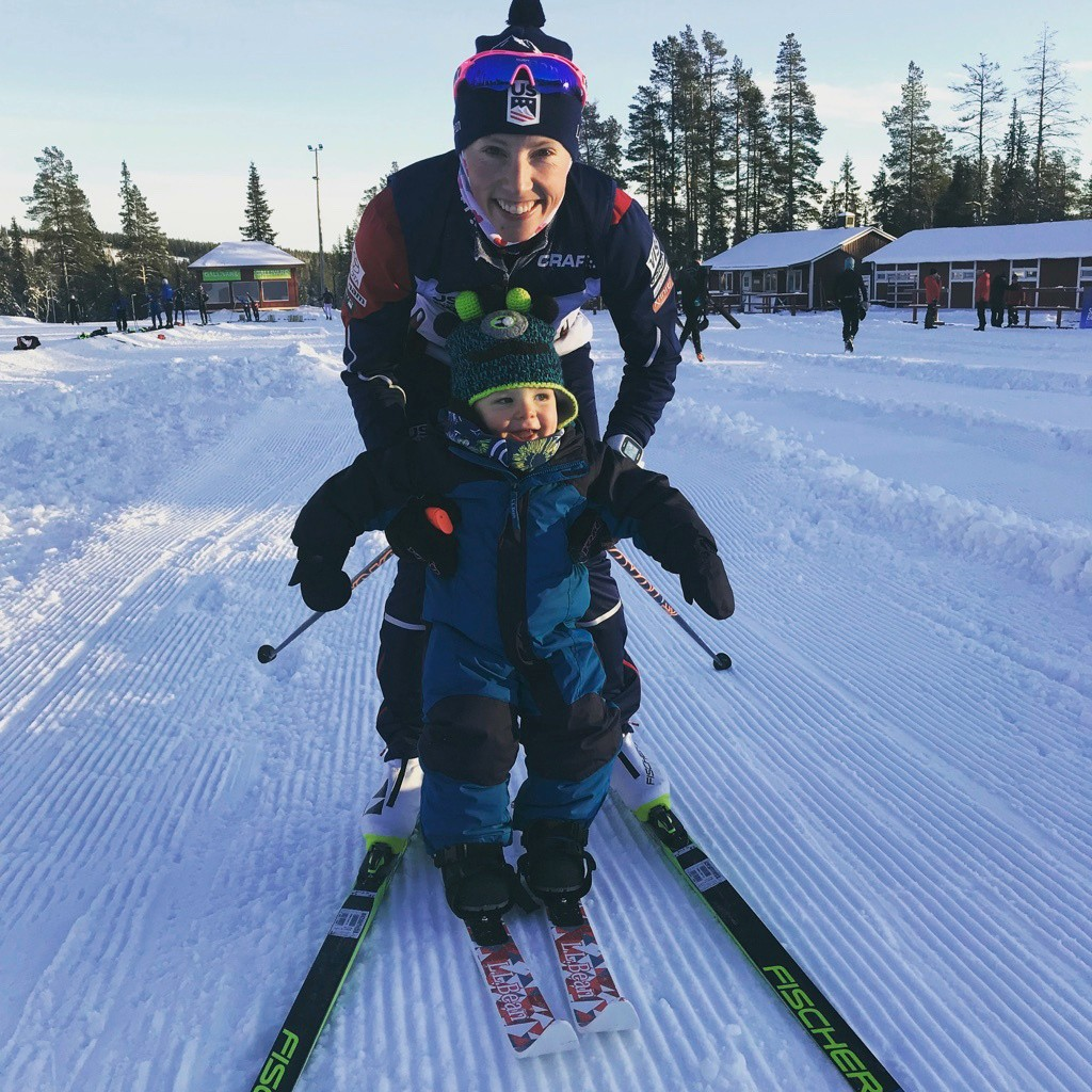 In this 2017 photo provided by U.S. cross-country skier Kikkan Randall, Randall poses with her son Breck in Gallivare, Sweden. Only a fraction of the