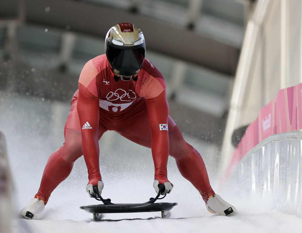 Sungbin Yun of South Korea brakes in the finish area after his second run during the men's skeleton competition at the 2018 Winter Olympics in Pyeongc