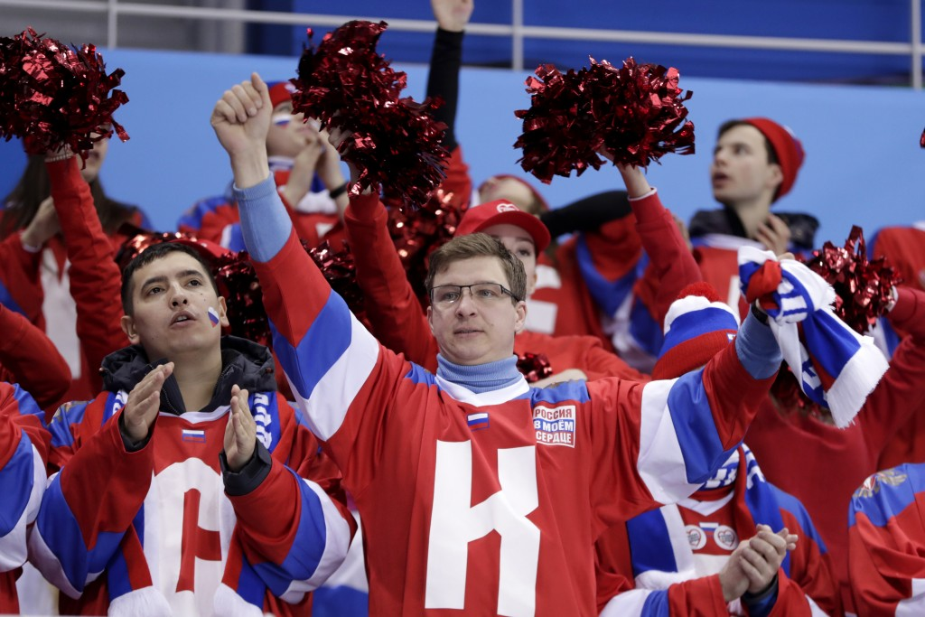 Fans of the Olympic Athletes from Russia cheer during the second period of a preliminary round women's hockey game against Finland at the 2018 Winter